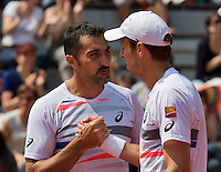 France, Paris, 31.05.2014. Tennis, French Open, Roland Garros, Daniel Nestor (CAN) and his doubles partner Nenad Zimonjic (SRB) defeat Rojer/Tecau<br /> Photo:Tennisimages/Henk Koster