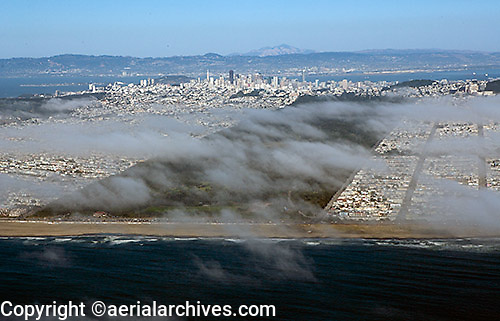 aerial photograph of Golden Gate Park, San Francisco through a layer of fog from Ocean Beach to the San Francisco skyline