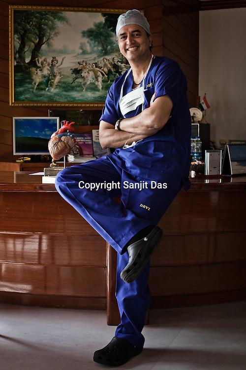 58 year old heart surgeon, Dr. Devi Prasad Shetty poses for a photo in his office at the Narayana Hrudayalaya in Bangalore, Karnataka, India. Photo: Sanjit Das/Panos