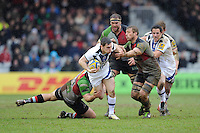 Tom Heathcote of Bath Rugby is tackled by Mark Lambert (left) and Chris Robshaw of Harlequins during the Aviva Premiership match between Harlequins and Bath Rugby at the Twickenham Stoop on Saturday 13th April 2013 (Photo by Rob Munro)