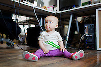 10-month-old Sadie Gutner wears a Mimo onesie with sensors at the Mimo headquarters Boston, Massachusetts, USA, on Mon., April 28, 2014. Sadie is the daughter of Mike Gutner who handles operations for Mimo, and she is wearing one of the company's onesies, made by Mimo, which has a variety of sensors on it. The onesie has a detachable frog-shaped communication device that transmits data from the onesie's sensors and sends the data to a smartphone app, which displays information about the baby's respiration, skin temperature, position, and activity level. The onesie is washable and the device is water-resistant.