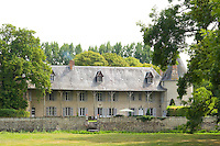 The garden facade of the 17th century chateau seen from the park