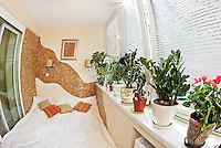 Sunny bedroom on balcony with Window and plants, fisheye view