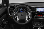 Car pictures of steering wheel view of a 2018 Mitsubishi Outlander PHEV Instyle 5 Door SUV