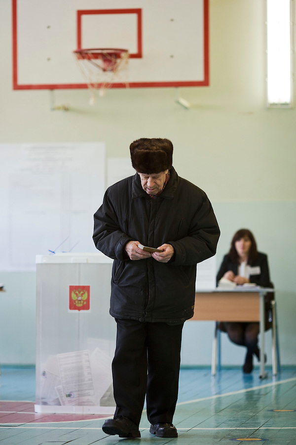 Moscow, Russia, 04/03/2012..A man walks away from the ballot box after casting is ballot on a basketball court as Russians vote in the Presidential election, which Prime Minister Vladimir Putin is expected to win in the first round.