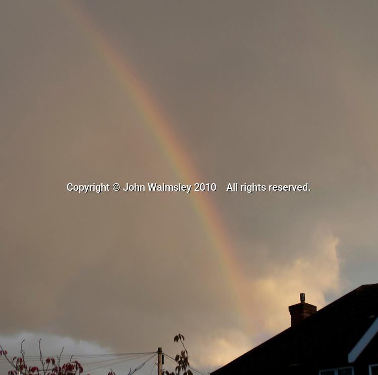 Rainbow over suburban housing.