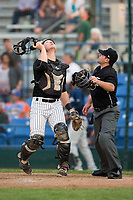 Great Falls Voyagers catcher Nate Nolan (18) tracks a pop fly as home plate umpire Phil Bando looks on during the game against the Helena Brewers at Centene Stadium on August 19, 2017 in Helena, Montana.  The Voyagers defeated the Brewers 8-7.  (Brian Westerholt/Four Seam Images)