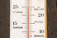 Old thermometer on the wall. Marked with Sik Room, Silk Worm, Room Temperature, and other strange words. Domaine Marc Kreydenweiss, Andlau, Alsace, France