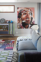 The upstairs rumpus room is decorated with affordable, quality South African furniture including pieces from Coricraft and Sofaworx. The room also features a painting by Nick Lepard and The Raintaster sculpture by Frank van Reenen.