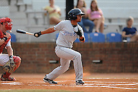 Bluefield Blue Jays third baseman Andy Fermin #4 swings at a pitch during the first game of the 2011 Championship Series between the Bluefield Blue Jays and the Johnson City Cardinals at Howard Johnson Field on September 3, 2011 in Johnson City, Tennessee.  The Cardinals won the game 4-3.  (Tony Farlow/Four Seam Images)