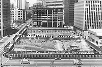 1978<br />  FILE PHOTO - ARCHIVES -<br /> <br /> 1978 FILE PHOTO -<br /> <br /> The tempo of building is stepping up once again in Toronto's downtown core. Here is a view of the excavation under way for the second tower of First Canadian Place. The lower portion will contain walkways on three levels; elaborately landscaped with openings to skylights; so the pedestrian will know where he is and what the weather is doing at all times; Laszlo Nemeth; 34; the chief architect for the seven-acre First Canadian Place complex rising at the King and York corner; said.