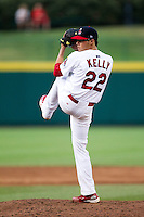 Joe Kelly (22) of the Springfield Cardinals winds up during a game against the Northwest Arkansas Naturals at Hammons Field on July 31, 2011 in Springfield, Missouri. Northwest Arkansas defeated Springfield 9-1. (David Welker / Four Seam Images)