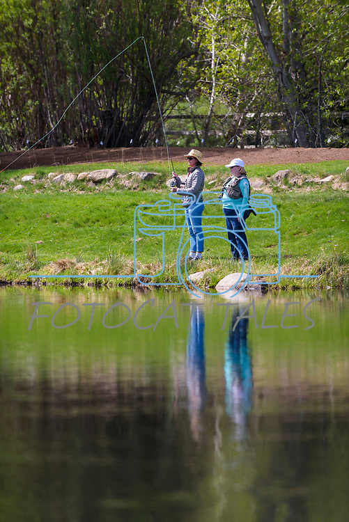 Susan Swezy learns to fly fish with her River Buddy Amy Kileen during the Casting for Recovery fishing clinic at Bently Ranch in Gardnerville, Nev. May 4, 2018.<br /> Photo by Candice Vivien/Nevada Momentum