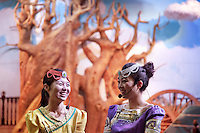 China. Shanghai. World Expo. Expo 2010 Shanghai China.  China Pavilion. Two chinese guides, talking together and laughing, at the entrance of the Inner Mongolia pavilion. Fake tree. 25.06.10 © 2010 Didier Ruef