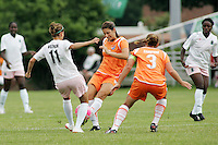 Angie Woznuk #11 goes into tackle with Yael Averbuch...Saint Louis Athletica defeated Sky Blue FC 1-0 at Anheuser-Busch Soccer Park, Saint Louis, MO.