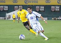 El Salvador midfielder Eliseo Quintanilla (10) goes against Jamaica midfielder Je-vaughn Shelton (15)  Jamaica defeated El Salvador 2-0 in a international friendly match at RFK Stadium, Wednesday August 15, 2012.