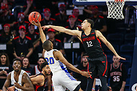 Washington, DC - March 10, 2020: Northeastern Huskies guard Jordan Roland (12) tries to block Hofstra Pride guard Jalen Ray (20) shot during the CAA championship game between Hofstra and Northeastern at  Entertainment and Sports Arena in Washington, DC.   (Photo by Elliott Brown/Media Images International)
