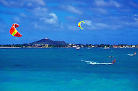 Kitesurfers flock to the waters off Kailua Beach on Oahu to take advantage of strong trade winds.