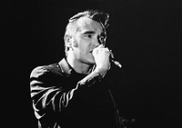 03 June 2020 - Morrissey showed his solidarity for Black Lives Matter on Twitter with the hashtag #TheShowMustBePaused to support the music community's Blackout Tuesday. While some of Morrissey's fans praised his showing of solidarity, others criticized the tweet because of his often controversial political views in the past.  File Photo: Morrissey performs on stage in 2000 at Hamilton Place Theatre, Hamilton, Ontario, Canada. (Editors Note: This image has been converted to black and white) Photo Credit: Brent Perniac/AdMedia