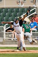 Kannapolis first baseman Brandon Allen (36) stretches for a throw as Augusta right fielder Tyler Graham (16) beats out an infield hit at Fieldcrest Cannon Stadium in Kannapolis, NC, Monday, September 3, 2007.