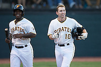 Jordan George (10) of the Bristol Pirates is all smiles after hitting his first professional home run in a game against the Burlington Royals at Boyce Cox Field on July 10, 2015 in Bristol, Virginia.  The Pirates defeated the Royals 9-4. (Brian Westerholt/Four Seam Images)