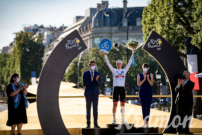 Tadej Pogacar (SVN/UAE-Emirates) on the podium in Paris as the winner of the white jersey as the best young rider<br /> <br /> Stage 21 (Final) from Chatou to Paris - Champs-Élysées (108km)<br /> 108th Tour de France 2021 (2.UWT)<br /> <br /> ©kramon