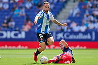 12th September 2021: Barcelona, Spain:  Sergi Darder of RCD Espanyol skips a tackle from Antoine Griezmann of Atletico de Madrid during the Liga match between RCD Espanyol and Atletico de Madrid at RCDE Stadium in Cornella, Spain.