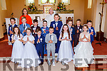 Pupils from Scartaglen NS with Fr Sean Horgan and teacher Eilish McCArthy after receiving their First Holy Communion on Saturday