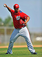 20 February 2011: Washington Nationals' pitcher Livan Hernandez takes some fielding practice during Spring Training at the Carl Barger Baseball Complex in Viera, Florida. Mandatory Credit: Ed Wolfstein Photo