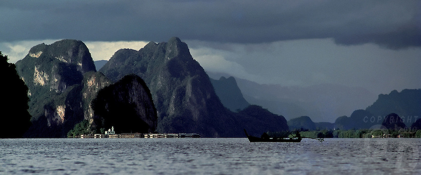 A storm over Phang Nga Bay in the southern tip of Thailand, a Muslim village sitting just below the cliffs,Thailand