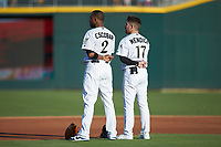 (L-R) Charlotte Knights infielders Alcides Escobar (2) and Danny Mendick (17) stand for the National Anthem prior to the game against the Buffalo Bisons at BB&T BallPark on July 24, 2019 in Charlotte, North Carolina. The Bisons defeated the Knights 8-4. (Brian Westerholt/Four Seam Images)