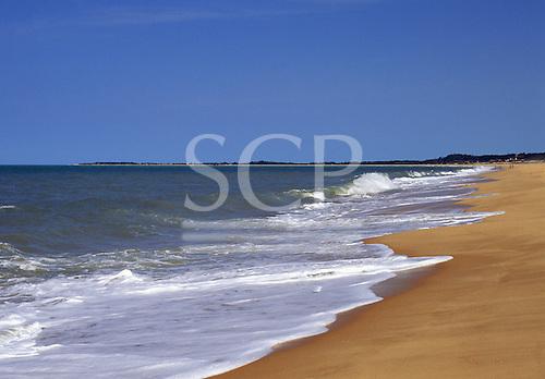 Porto Seguro, Bahia, Brazil. Waves breaking on the golden sand of the beach at Santa Cruz de Cabralia.