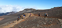 Horseback riders on the Sliding Sands Trail in Haleakala National Park, Maui.