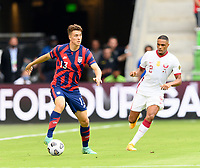 AUSTIN, TX - JULY 29: Matthew Hoppe #13 of the United States looks to pass the ball in front of Pedro Miguel #2 of Qatar during a game between Qatar and USMNT at Q2 Stadium on July 29, 2021 in Austin, Texas.