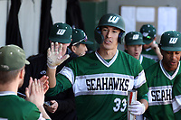 CARY, NC - FEBRUARY 23: Freddy Sabido #33 of Wagner College celebrates in the dugout after scoring the go ahead run in the top of the eleventh inning during a game between Wagner and Penn State at Coleman Field at USA Baseball National Training Complex on February 23, 2020 in Cary, North Carolina.