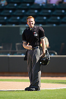 Home plate umpire Chase Eade during the Carolina League game between the Wilmington Blue Rocks and the Winston-Salem Dash at BB&T Ballpark on July 6, 2014 in Winston-Salem, North Carolina.  The Dash defeated the Blue Rocks 7-1.   (Brian Westerholt/Four Seam Images)