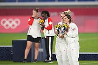 YOKOHAMA, JAPAN - AUGUST 6: Lindsey Horan #9 and Tobin Heath #7 of the United States pose for a photo during the 2020 Tokyo Olympics Women's Soccer medal ceremony at International Stadium Yokohama on August 6, 2021 in Yokohama, Japan.