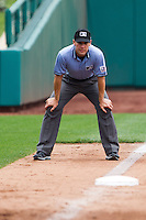 Third base umpire Jimmy Volpi watches down the third base line during a game between the Arkansas Travelers and the Springfield Cardinals on May 10, 2011 at Hammons Field in Springfield, Missouri.  Photo By David Welker/Four Seam Images...