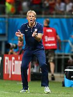 USA coach Juergen Klinsmann applauds on the touchline
