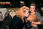 Pet dog owner kissing her dog  child substitute Crufts Dog Show 1990s UK 1991<br /> <br /> MISS EVALYN SMAIL KISSING HER POMERANIAN CALLED ' AMREICAN CHAMPION MULLER KASAR SUNGOLD ILLUSION AT TOYBOX'.,