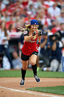 Olivia Holt runs to first base during the All-Star Legends and Celebrity Softball Game on July 12, 2015 at Great American Ball Park in Cincinnati, Ohio.  (Mike Janes/Four Seam Images)