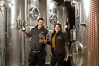 BNPS.co.uk (01202) 558833<br /> Pic: ZacharyCulpin/BNPS<br /> <br /> Coming up Rosé...<br /> <br /> Pictured: Fiona Wright of Langham Wine Estate and Vineyard Manager Oliver Whitfield celebrate with their 2017 rosé brut<br /> <br /> A English winemaker is celebrating after beating off worldwide competition to win gold for its sparkling rose wine.<br /> <br /> Langham Wine's 2017 rosé brut was awarded the gold standard at this year's International Wine and Spirit Competition.<br /> <br /> A panel of sommeliers selected just two other rosé wines from the entire northern hemisphere as worthy of the prestigious award.