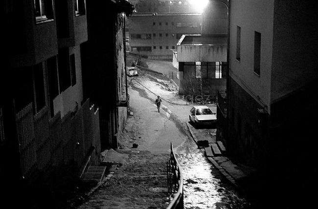 BOSNIA-HERZEGOVINA, Sarajevo, March 2003..10 years after the end of the war, I came for the first time in Sarajevo. I have in mind the images of the besieged city. The daily death, the impotence and the guilty inaction of the international community, the sad spectacle of a war in Europe. 10 years later, I walk the streets obsessed with the scars of war..Street in the night..BOSNIE-HERZEGOVINE, Sarajevo, Mars 2003..10 ans après la fin de la guerre, j'arrive pour la première fois à Sarajevo. J'ai encore en tête les images de la ville assiégée. La mort quotidienne, l'impuissance voire l'inaction coupable de la communauté internationale, le spectacle désolant d'une guerre en Europe. 10 après, je déambule dans les rues obsédé par les stigmates de la guerre..Rue dans la nuit..© Bruno Cogez