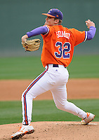 Starting pitcher Clate Schmidt (32) of the Clemson Tigers pitches in a game against the South Carolina Gamecocks on Saturday, March 2, 2013, at Fluor Field at the West End in Greenville, South Carolina. Clemson won the Reedy River Rivalry game 6-3. Freshman Schmidt pitched seven innings to pick up the win. (Tom Priddy/Four Seam Images)