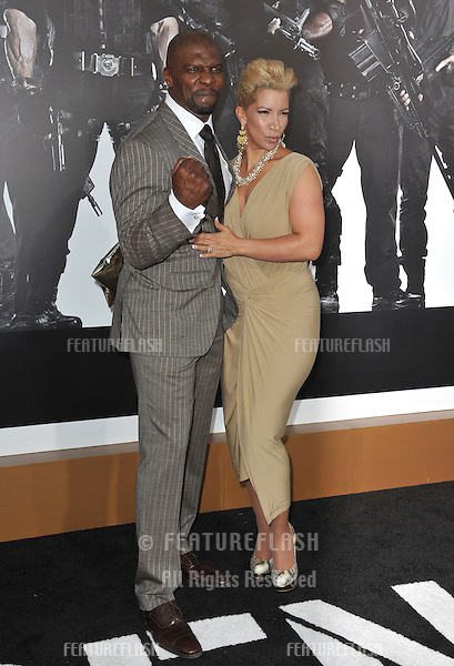 """Terry Crews & wife at the Los Angeles premiere of his movie """"The Expendables 2"""" at Grauman's Chinese Theatre, Hollywood..August 16, 2012  Los Angeles, CA.Picture: Paul Smith / Featureflash"""