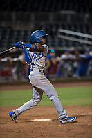 AZL Dodgers second baseman Albert Suarez (56) follows through on his swing during an Arizona League game against the AZL Indians 2 at Goodyear Ballpark on July 12, 2018 in Goodyear, Arizona. The AZL Indians 2 defeated the AZL Dodgers 2-1. (Zachary Lucy/Four Seam Images)