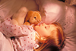 toddler girl sleeping with toy