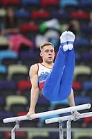 12th March 2020, Baku, Azerbaijan;  2020 Artistic World Cup Gymnastics Tournament;  Vladislav Poliashov, RUS, during qualification parallel bars
