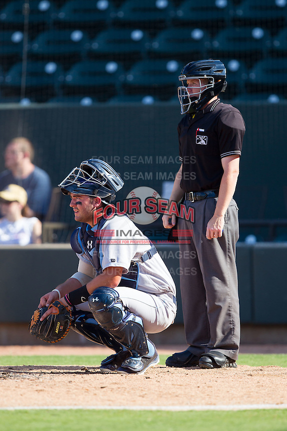 Wilmington Blue Rocks catcher Cam Gallagher (35) and home plate umpire Chase Eade wait for the next batter during the game against the Winston-Salem Dash at BB&T Ballpark on July 6, 2014 in Winston-Salem, North Carolina.  The Dash defeated the Blue Rocks 7-1.   (Brian Westerholt/Four Seam Images)