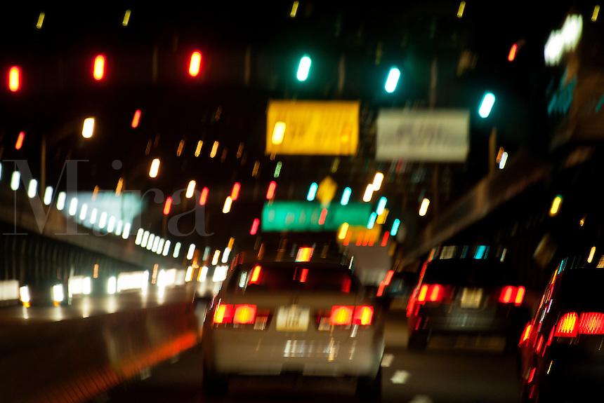 Heavy blurred traffic city bridge.